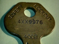 The bow of a Master Lock key, with keyway code (400B) and indirect bitting code (4XX9976) shown.