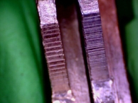 A comparison of two keys cut with different speed key machines. Notice the difference in the grain of the cuts.